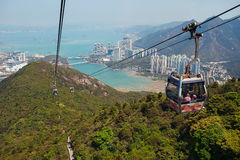 Chairlifts above the mountains. On a background of water and the city royalty free stock images