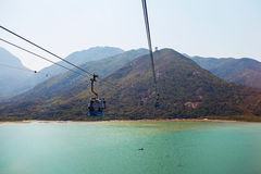 Chairlifts above the water. On a background of mountains stock photos