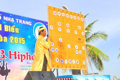 The chairman is explainning the martial arts of human chess in a festival on the beach of Nha Trang city Stock Photo
