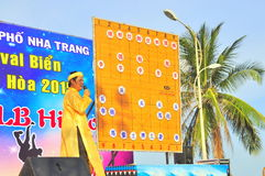 The chairman is explainning the martial arts of human chess in a festival on the beach of Nha Trang city Royalty Free Stock Images