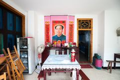 Chairman Mao poster inside a Chinese dining room. JIANGXI PROVINCE, CHINA - AUG 6, 2014 - Chairman Mao poster inside a Chinese dining room royalty free stock image
