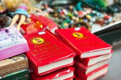 Chairman Mao`s Little Red Book on sale at Upper Lascar Row street market, Sheung Wan, Hong Kong. SHEUNG WAN, HONG KONG - NOV 11, 2013 - Chairman Mao`s Little Red stock photography