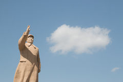 Chairman mao statue in front of blue sky Stock Photo