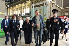 Chairman of the Moscow Helsinki group Lyudmila Alekseeva checks the security level of the Kiev railway station in Moscow. MOSCOW, RUSSIA - APRIL 21, 2014 Royalty Free Stock Photography