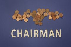 Chairman written with wooden letters on a blue background. To mean a business concept Stock Photo