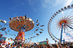 Chairoplane and big wheel at Oktoberfest Royalty Free Stock Photography