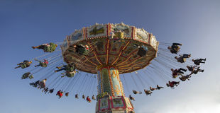 Chairoplane with people on octoberfest munich Stock Photography
