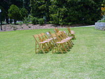 Chairs. Setting up chairs on the lawn for an event or ceremony royalty free stock photo