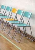 Chairs. Photo of row of colorful chairs in a indoor sports facility Royalty Free Stock Images