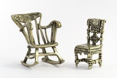 Chairs. Two small chairs in metal silver. Object isolated royalty free stock photography
