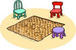 Chairs. Three chairs around a carpet Stock Photos