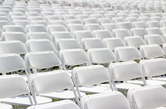 Chairs. Abstract of white folding chairs filling the whole frame Royalty Free Stock Image