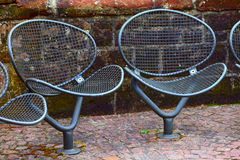 Chairs. A public metal chairs on the promenade  in small city Saarburg, Rheinland-Pfalz, Germany Stock Photography