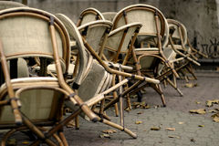 Chairs. Are waiting on the street for the better weather. There are autumn leafs everywhere Royalty Free Stock Image