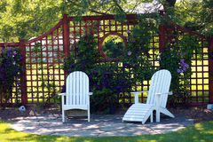 Chairs. Peaceful backyard retreat with flowers and chairs Stock Photography