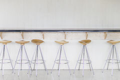 Chairs. Row of orange and yellow bar stools Royalty Free Stock Photo
