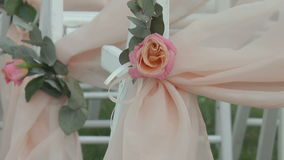 Chairs adorned with roses stock footage