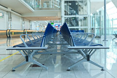 Chairs in airport boarding area Stock Photos
