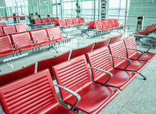 Chairs in the airport lounge area Stock Photos
