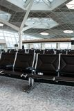 Chairs in  airport lounge area Stock Photos