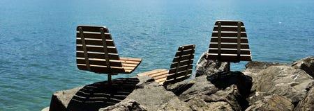 Chairs along the lake stock photo