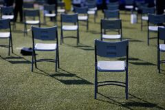 Free Chairs Apart One From Another To Maintain The Social Distance During The Covid-19 Outbreak At An Outdoor Event On The Turf Of A Royalty Free Stock Photos - 192153768