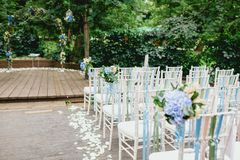 Chairs and arch from wedding ceremony Royalty Free Stock Photo