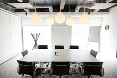 Chairs Around Boardroom Table In Empty Modern Meeting Room royalty free stock photography