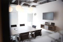Chairs Around Boardroom Table In Empty Modern Meeting Room royalty free stock images