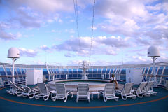 Chairs around a pool on a cruise Royalty Free Stock Image