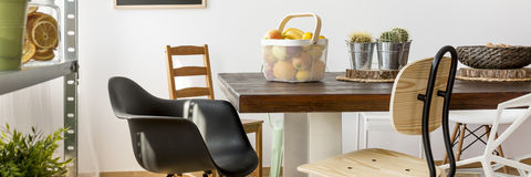 Chairs around wooden table stock photo
