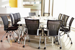 Chairs Arranged Around Empty Boardroom Table Stock Photos