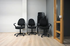 Chairs arranged in stack in new office Stock Photo