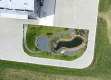 Artificial pond at a factory, resting place for the employees, a. Chairs and an artificial pond at a factory, resting place for the employees, aerial photo stock images