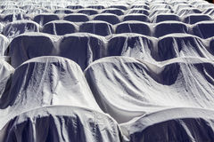 Chairs in the auditorium, covered with a white cloth to protect from dust and dirt Stock Photography