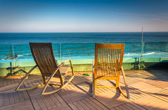 Chairs on a balcony overlooking the Atlantic Ocean at Revel Hote Stock Photos