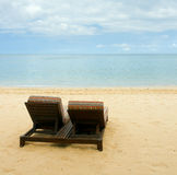 Chairs on beach. Chairs on a deserted beach Stock Photo