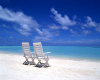 Chairs beside beach Royalty Free Stock Photo