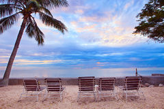 Chairs beach arrangement on sand location against beautiful sun Royalty Free Stock Image