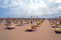 Chairs, beach chairs and umbrellas closed Stock Photos