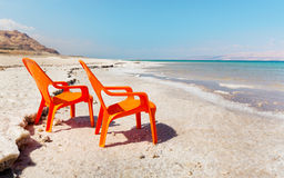 Chairs on beach of dead sea Stock Photography