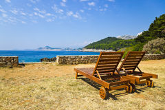 Chairs on beach at Dubrovnik, Croatia Royalty Free Stock Photography