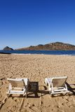 Chairs on the Beach Face Deer Island in Mazatlan Mexico royalty free stock images