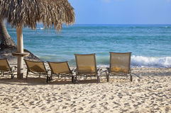 Chairs on beach in front of ocean Royalty Free Stock Photos