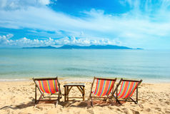 Chairs on beach near the sea Royalty Free Stock Image