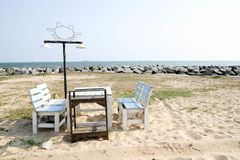 Chairs on beach stock images