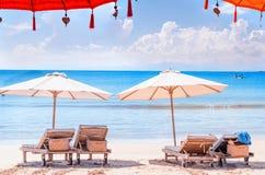 Chairs at beach. Sun lounger and umbrella at Bali shore. royalty free stock images