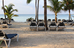 Chairs on the Beach on the Sunset. Barcelo Maya Colonial Resort, Riviera Maya stock photography