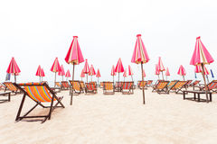 Chairs beach and umbrella on sand beach Stock Image