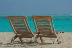 Chairs on the beautiful beach at the tropical island at resort. At Maldives Royalty Free Stock Photography